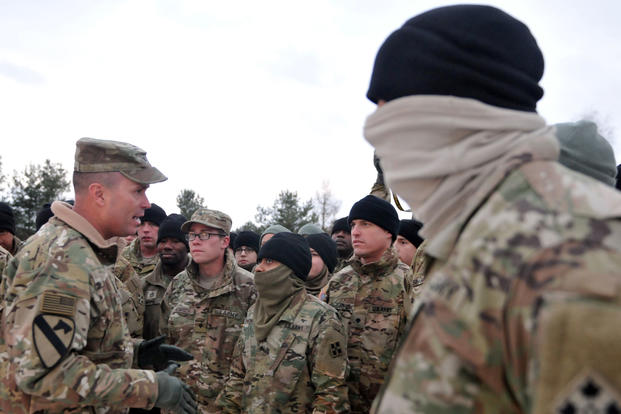 Col. Christopher R. Norrie, commander of 3rd Armored Brigade Combat Team, 4th Infantry Division gives his Soldiers a safety brief before conducting the final day of their convoy crossing into Poland from Germany, Jan. 12, 2017. (U.S. Army/Elizabeth Tarr)