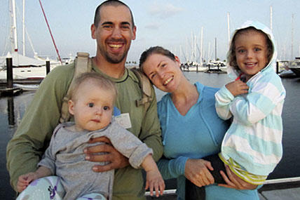 Eric and Charlotte Kaufman, their 1-year-old daughter Lyra and her 3-year-old sister, Cora.