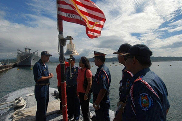 Command Master Chief Jim Lyle offers a tour of the USS Pasadena on a stop through the Philippines at Subic Bay. (U.S. Navy photo)