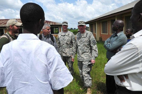 A US team along with city officials in Ganta, Liberia, survey an area for construction of an Ebola treatment unit Nov. 3, 2014. (U.S. Army photo by Sgt. 1st Class Nathan Hoskins, Joint Forces Command - United Assistance Public Affairs)
