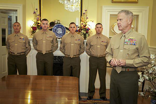 Former Marine Commandant Gen. James F. Amos awards the Navy Marine Corps Commendation Medal to four Marine enlisted aides. Marine Corps photo