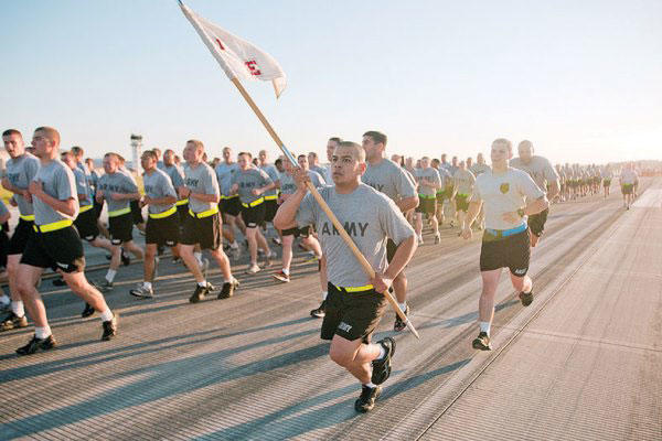A CAB Soldier charges alongside a formation May 26 during a brigade run at Marshall Army Airfield. (Army photo)