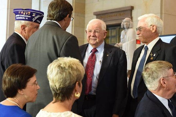 Retired Cols. William Driggers Jr. and Michael Brazelton  speak with other Vietnam War vets during the Congressional Commemoration of the Vietnam War at U.S. Capitol in Washington, July 8, 2015. (U.S. Air Force photo/Staff Sgt. Carlin Leslie)