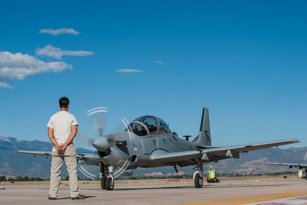 An Afghan maintainer waits as an 81st Fighter Squadron instructor pilot and Afghan pilot get ready to take off for high-altitude training at Peterson Air Force Base, Colo., Sept. 16, 2015. (U.S. Air Force photo/Airman 1st Class Rose Gudex)