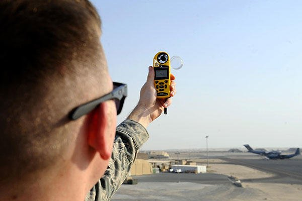 Senior Airman David Baily, a 386th Expeditionary Operations Support Squadron weather forecaster, uses a handheld wind meter to determine wind gusts in Southwest Asia, Oct. 16, 2015. (U.S. Air Force/Staff Sgt. Tyler Alexander)