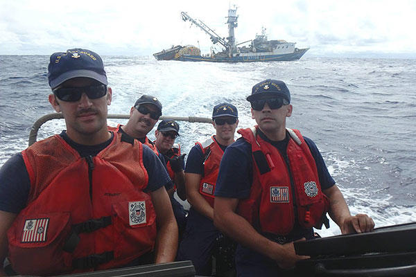 A USCGC Kukui (WLB 203) boarding team, with a shiprider from the Republic of the Marshall Islands, aboard a small boat departs the fishing vessel Lomato following a boarding in the Pacific Ocean Aug. 29, 2015. (U.S. Coast Guard photo)