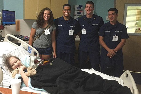 Members from the Coast Guard Cutter Resolute visit Rose Kerney at All Children's Hospital in St. Petersburg, Fla. (U.S. Coast Guard)