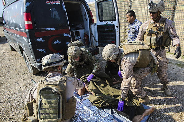 U.S. Navy corpsmen and a member of the U.S. Army 772nd Forward Surgical Team prepare an Iraqi soldier that sustained combat-related injuries for transport. (U.S. Marine Corps/Sgt. Ricardo Hurtado)