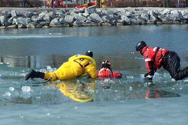Members from Coast Guard Station Milwaukee and local first responders prepare to conduct ice rescue training in Milwaukee, Feb. 28, 2016. (Coast Guard photo by Lt. j.g. Tom Morrell)