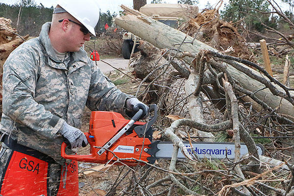 Virginia National Guard soldiers clear debris to open a blocked road in Essex County, Va.. More than 40 Virginia National Guard soldiers are on state active duty assisting with cleanup operations. (Virginia National Guard photo by Cotton Puryear)