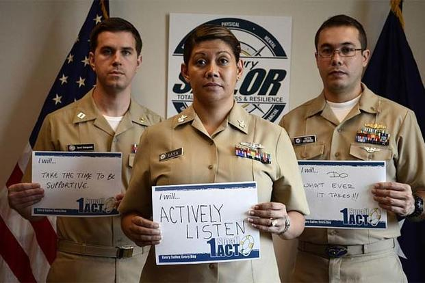 Lt. David Dziengowski, left, Yeoman 1st Class Silvia Raya, and Lt. j.g. Victor Gutierrez, from the Chief of Naval Personnel office, show support as part of Suicide Prevention Month. (US Navy Photo)