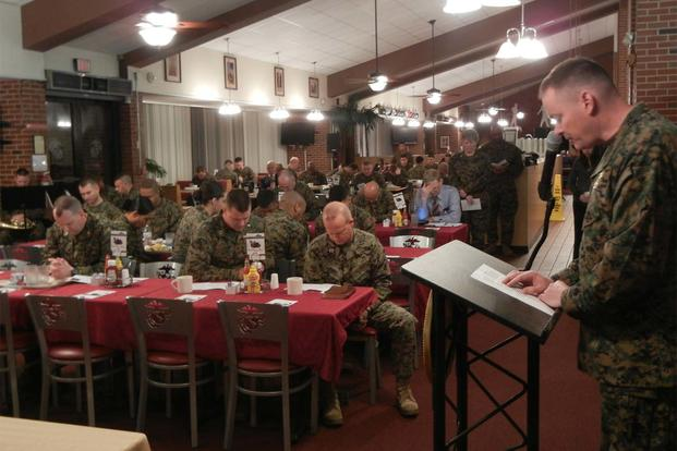 "Lt. Cmdr. Robert Burns, Marine and Family Programs Division chaplain, leads a prayer based on the opening lines of the ""Our Father"" at the National Prayer Breakfast Feb. 12 at Bruce Hall, Quantico. (Marine Photo)"