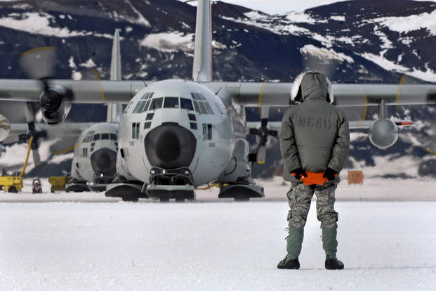 An LC-130 Hercules is marshaled from its parking spot on the annual sea ice runway near McMurdo Station, Antarctica, during Operation Deep Freeze. Tech. Sgt. Shane A. Cuomo/Air Force