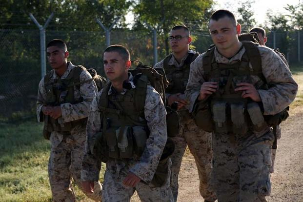 Marines wore improved plate carrier body armor and assault packs during a 10-mile hiking competition Aug. 26, 2014 around Mihail Kogalniceanu Air Base, Romania. (Marine Corps Photo/ Lance Cpl. Ryan Young)