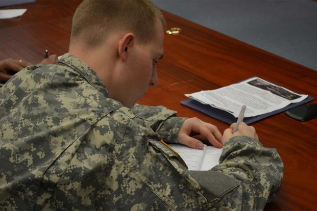 Pfc. Mark A. Jones takes notes during a brief on financial readiness Feb. 27, 2013 in the 2nd Combat Aviation Brigade's Talon Academy classroom on Camp Humphreys. (Photo Credit: Staff Sgt. Aaron P. Duncan)