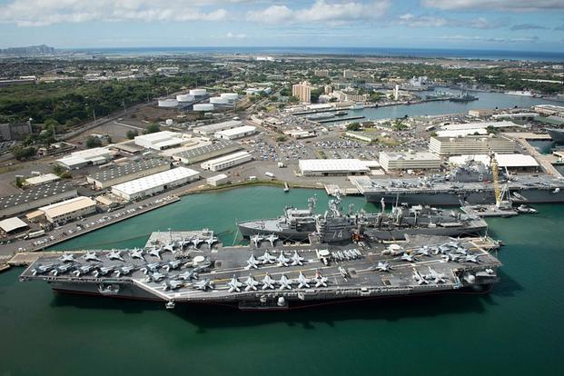 An aerial view of ships moored at Joint Base Pearl Harbor-Hickam in June 2016. U.S. Navy Combat Camera photo by Mass Communication Specialist First Class Ace Rheaume
