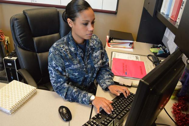 FILE -- Aviation Boatswain's Mate (Handling) 2nd Class Britani Parker, assigned to the air operations department at Naval Station Norfolk, completes administrative tasks. (U.S. Navy/Mass Communication Specialist 3rd Class Jeanyra A. Mateo)