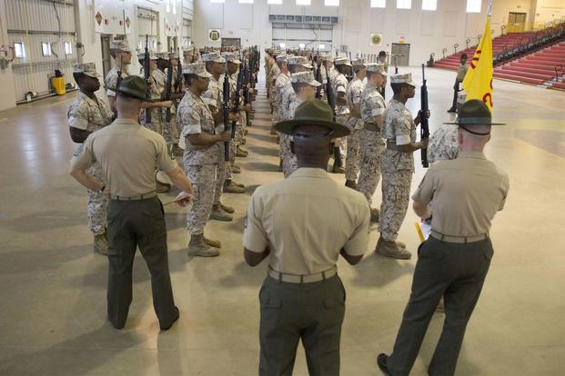 FILE -- Regimental drillmasters critique recruits during an initial drill evaluation Sept. 29, 2014, at Marine Corps Recruit Depot Parris Island, S.C. (Marine Corps/ Cpl. Caitlin Brink)