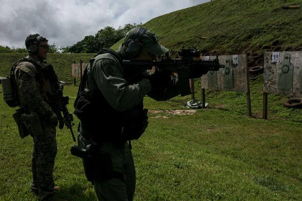 Marine Sgt. Luis Martinez conducts a live-fire range with police officers and SWAT members of the Guam Police Department at Anderson Air Force Base, Guam, Feb. 7, 2017. (U.S. Marine Corps/Lance Cpl. Jorge A. Rosales)