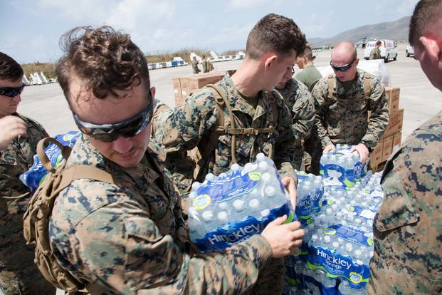 U.S. Marines with the 26th Marine Expeditionary Unit (MEU), unload emergency care items at the St. Thomas Cyril E. King Airport, U.S. Virgin Islands, Sept. 12, 2017. (U.S. Marine Corps/Lance Cpl. Alexis C. Schneider)