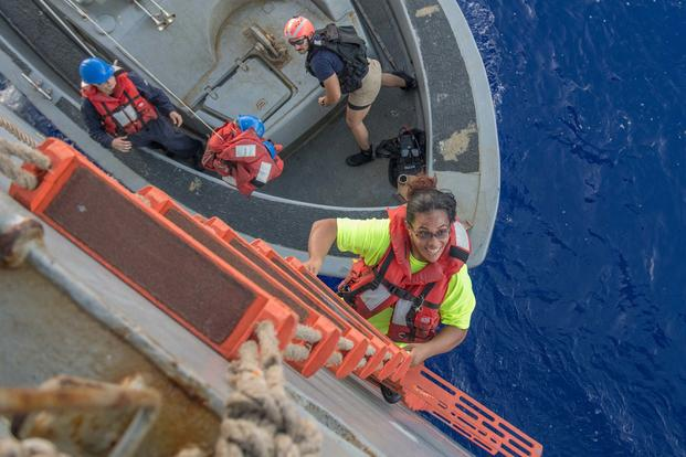 Tasha Fuiaba climbs the accommodation ladder to board the amphibious dock landing ship USS Ashland. (U.S. Navy/Mass Communication Specialist 3rd Class Jonathan Clay)