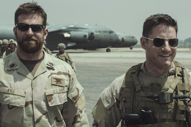 "Caption: (L-r) BRADLEY COOPER as Chris Kyle and SAM JAEGER as Navy Seal Lt. Martin in Warner Bros. Pictures' and Village Roadshow Pictures' drama ""AMERICAN SNIPER,"" distributed worldwide by Warner Bros. Pictures."