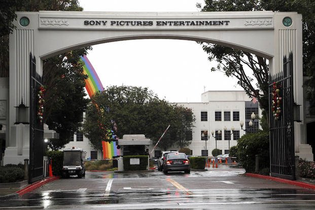 In this Dec. 2, 2014 file photo, cars enter Sony Pictures Entertainment headquarters in Culver City, Calif.