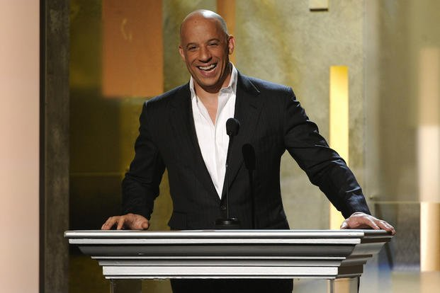 In this Feb. 22, 2015 file photo, Vin Diesel speaks on stage at the 45th NAACP Image Awards at the Pasadena Civic Auditorium in Pasadena, Calif.