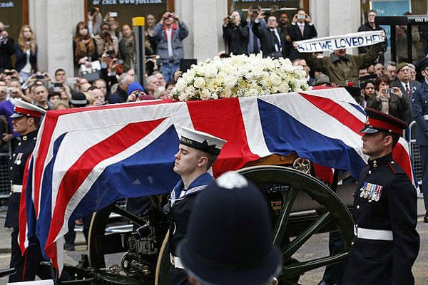 A Union flag draped coffin bearing the body of former British Prime Minister Margaret Thatcher is carried on a gun carriage drawn by the King's Troop Royal Artillery during her ceremonial funeral procession in London, Wednesday, April 17, 2013