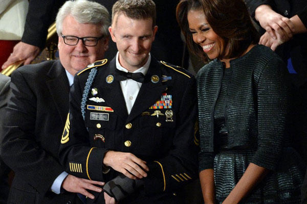 Sgt. First Class Cory Remsburg stands with first lady Michelle Obama before President Barack Obama delivered his State of the Union speech during a joint session of Congress on Jan. 28, 2014. (Olivier Douliery/Abaca Press)