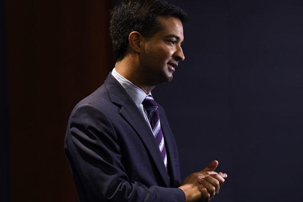 In this Nov. 13, 2014, file photo, Rep.-elect Carlos Curbelo, R-Fla., does a television interview on Capitol Hill in Washington. Susan Walsh/AP