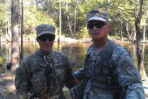 Timothy Spayd, 54, a former Army Ranger who has amyotrophic lateral sclerosis (ALS), takes a photo with Capt. Kristen Griest, one of the first two women in history to complete Ranger School, while volunteering with the swamp phase in Florida in 2015.