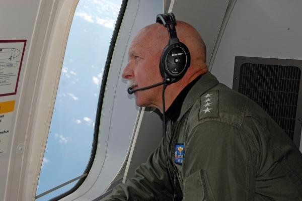 Adm. Scott Swift, commander of U.S. Pacific Fleet, observes operations aboard a P-8A Poseidon aircraft during a flight over the South China Sea on July 18, 2015. (U.S. Navy photo by Tyler R. Fraser)