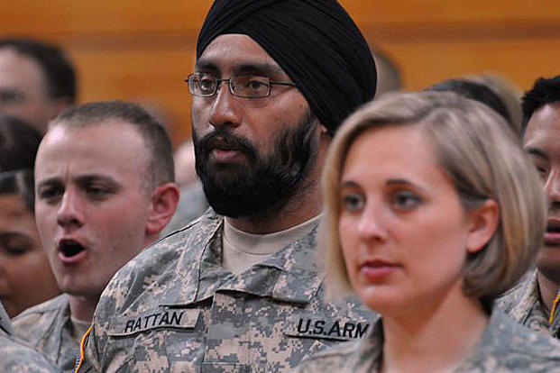 "Capt. (Dr.) Tejdeep Singh Rattan, a dentist, joins his graduating class in singing ""The Army Goes Rolling Along"" during the Basic Officer Leadership Course graduation ceremony, March 22, 2010, at Fort Sam Houston, Texas. Steve Elliott/Army"