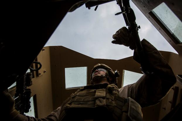 A U.S. Marine with Special Purpose Marine Air Ground Task Force-Crisis Response-Central Command mans the turret gun of a Humvee during a patrol in Al Taqaddum, Iraq, Jan. 1, 2016. (Photo by Rick Hurtado/U.S. Marine Corps)