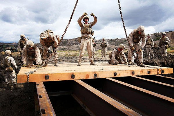 Marines building bridge