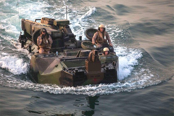 Members of the 22nd Marine Expeditionary Unit operate with the Bataan Amphibious Ready Group in the Arabian Gulf. The group was at sea for nearly 11 months in 2012, the longest naval deployment since World War II. (Marine Corps/Austin Hazard)