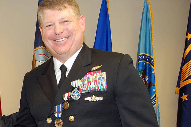 Rear Adm. Robert Gilbeau smiles after receiving the Defense Superior Service Medal, the Afghanistan Campaign Medal and the NATO Medal during a ceremony at Fort Lee, Va., on Nov. 27, 2012. DoD photo