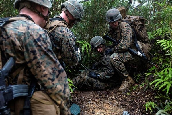 U.S. Marines practice casualty evacuations on May 19, 2016, at the Jungle Warfare Training Center, Camp Gonsalvas, Okinawa, Japan. (Photo by Jessica N. Etheridge/U.S. Marine Corps)