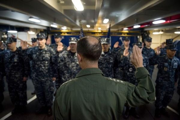 Chief of Naval Operations Navy Adm. John Richardson reenlists sailors aboard the USS John C. Stennis aircraft carrier, on June 5, 2016, in the South China Sea. (Photo by Kenneth Rodriguez Santiago/U.S. Navy)