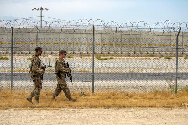 Airmen patrol the flightline perimeter at Bagram Airfield, Afghanistan, last June. (US Air Force photo/Justyn Freeman)