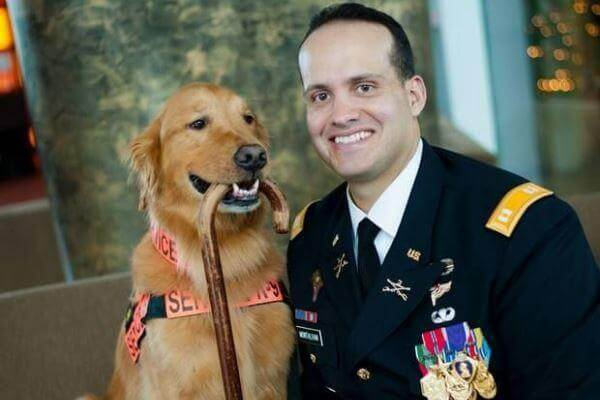 Former U.S. Army Capt. Luis Carlos Montalvan and his service dog, Tuesday, visited many local libraries to talk about his books. (Publicity photo)
