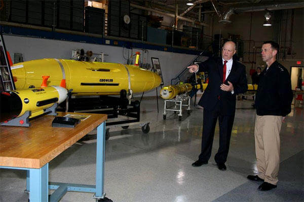 Chief of Naval Operations John Richardson (right) takes a look at Navy unmanned underwater systems last January at the Naval Oceanographic Office (US Navy photo/Becky Eckhoff)