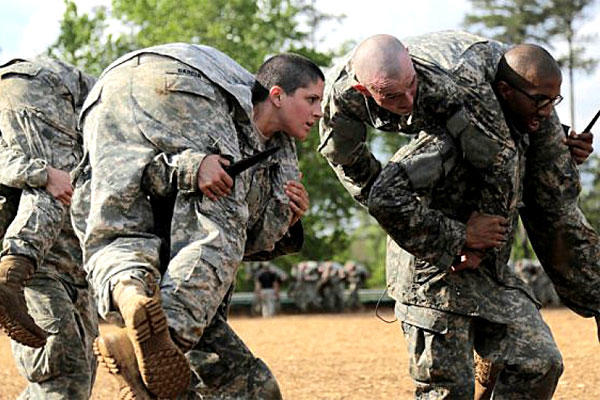 Army Capt. Kristen Griest carries a soldier during Ranger School at Fort Benning, Ga. She was one of the first two women to make it through the 62-day leadership course. (US Army photo)
