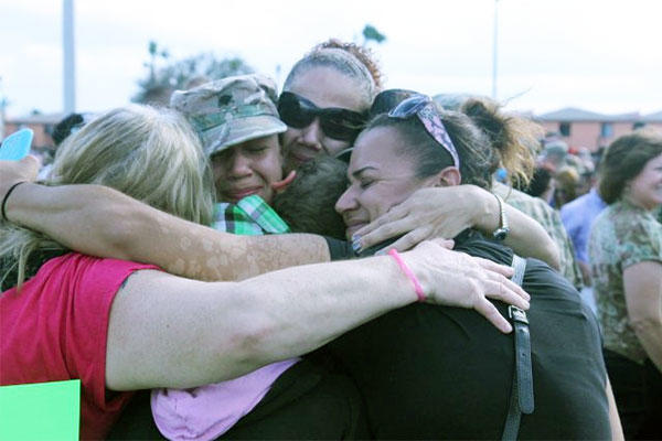 National Guard family members give a group hug after a deployment. U.S. Army photo