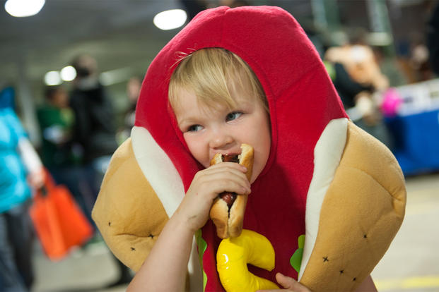 A military child attends a Trunk or Treat event on Minot Air Force Base, North Dakota. (Photo: U.S. Air Force/Airman 1st Class Apryl Hall.)
