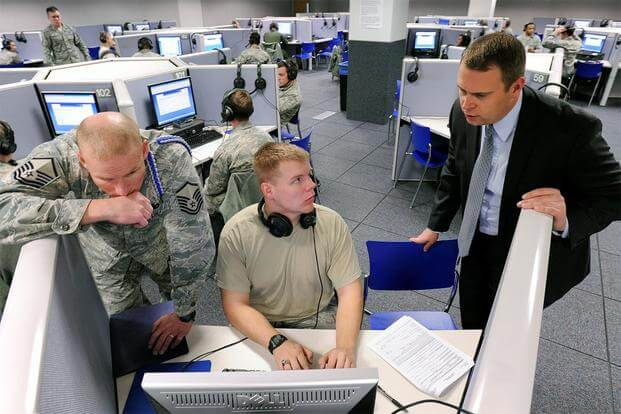 Information Protection Directorate officials process between 650 and 700 cadet applications for top-secret clearance annually. (Photo: Mike Kaplan)