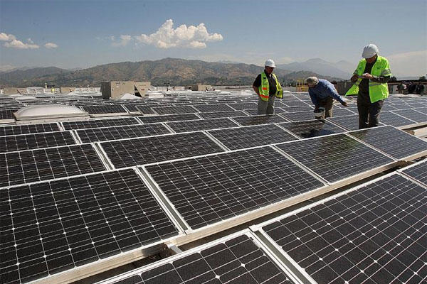 solar panels and workers