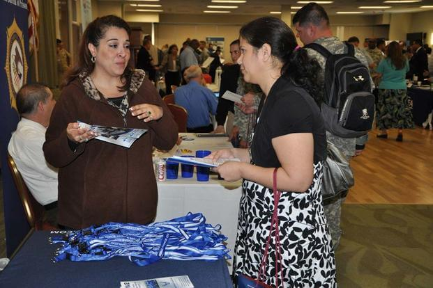 Amy Ruiz, Air Force Personnel Center human resources specialist, provides information about Air Force civilian careers to an attendee during the Hiring Heroes Career Fair at Joint Base San Antonio-Fort Sam. (Air Force photo)
