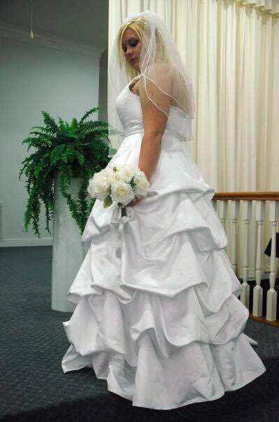 Justi Bates in her wedding gown. Instead of just keeping it in her closet, she she sent it off to be made into angel gowns for infants who don't make it out of the hospital. ((Photo courtesy of Justi Bates.)